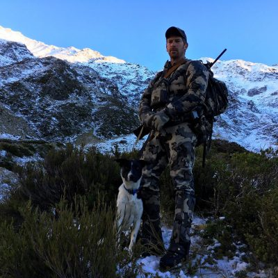 Chris McCarthy with dog cook hunting Tahr